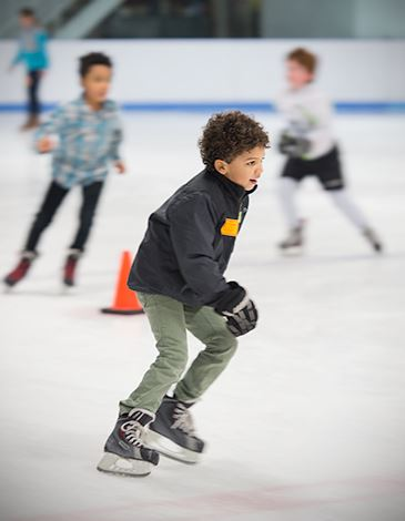 Young boy ice skating