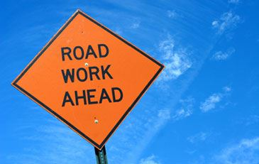 Orange Road Work Ahead sign