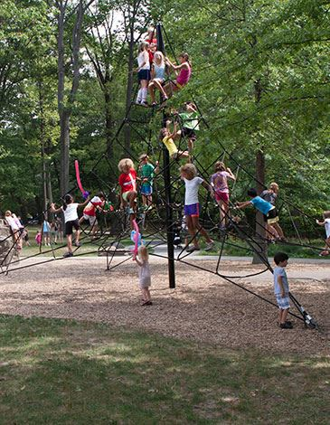 Kids playing on spider structure at Horseshoe Lake Park
