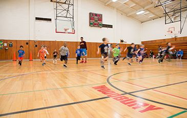 Kids playing basketball at Woodbury School